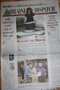 behind the bricks newspaper 001